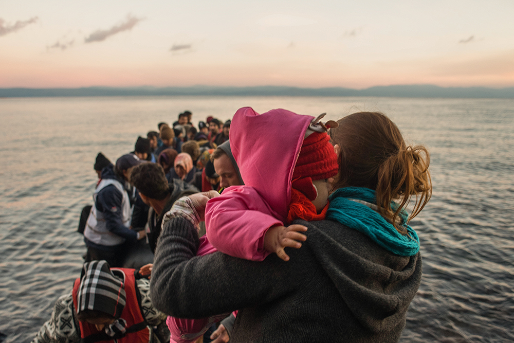 A dinghy arrives in Lesvos, Greece with more than 60 Syrian refugees, most of them children.