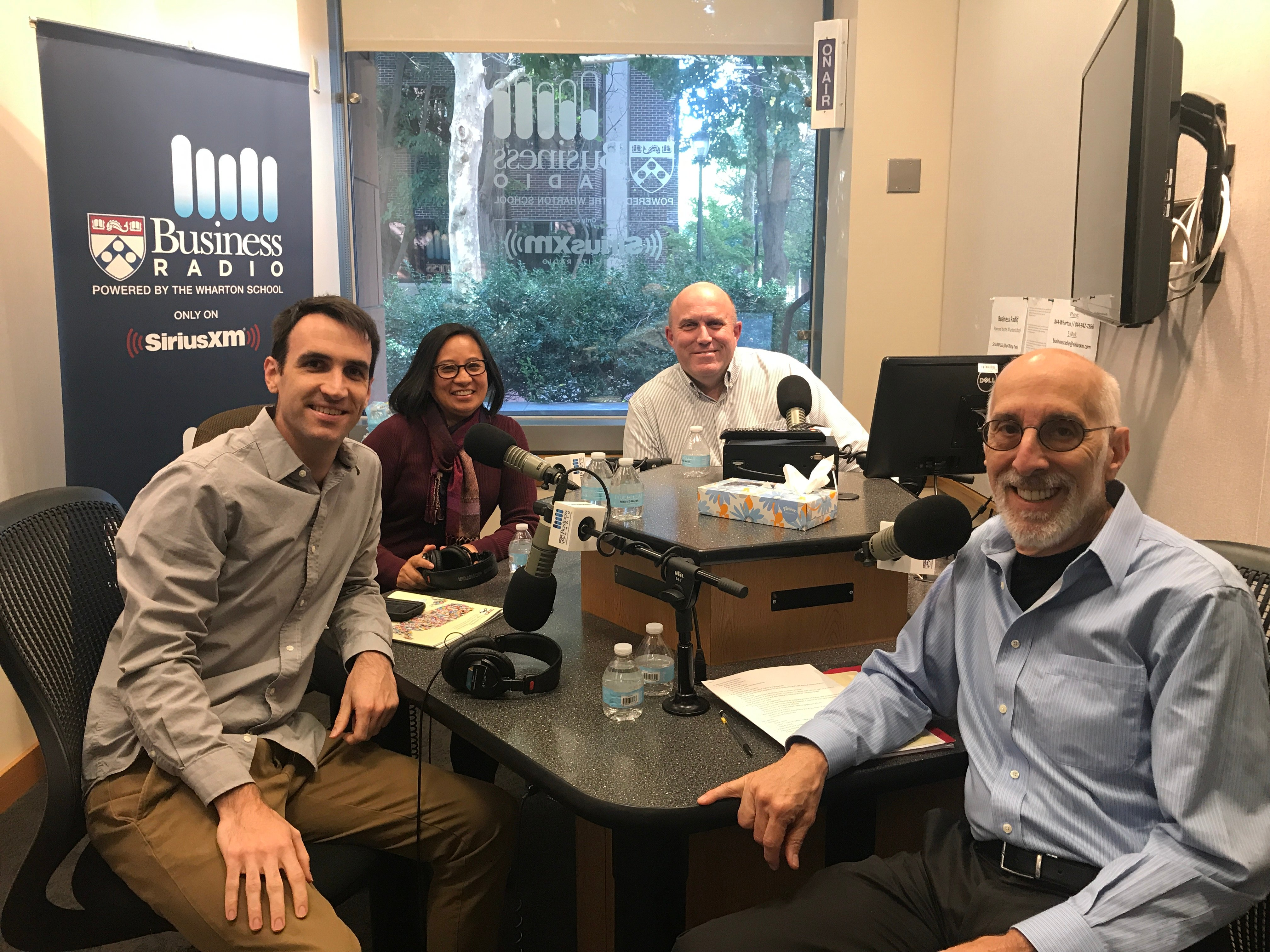 Conor Carroll, Kat Rosqueta, Dan Loney, and Harris Sokoloff at the Wharton Business Radio studio