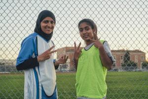 Two girls in soccer gear